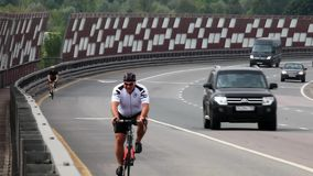 Traveling cyclists on the roads and streets of Moscow stock video footage