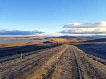 Traveling down the gravel road in desert. Kjolur Highland route F35 Volcanic Iceland Stock Image