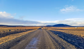 Traveling down the gravel road in desert. Kjolur Highland route F35 Volcanic Iceland Stock Images