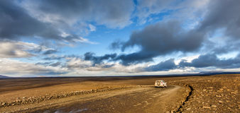 Traveling down the gravel road in desert Royalty Free Stock Photo