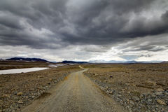 Traveling down a gravel road in Iceland. The dirt road F550 passes the Mars-like landscape of Kaldidalur Royalty Free Stock Photography
