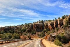 Traveling. Driving down a Southwestern highway with colorful rock formations Stock Image