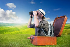 Traveling explorer observes nature. From a luggage Stock Photos