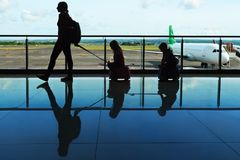 Traveling family in airport stock image