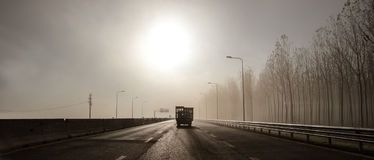 Traveling in the fog at the morning Stock Images