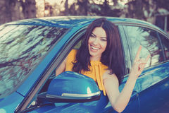 Traveling with fun. Happy woman enjoying road park trip in her new car Stock Images