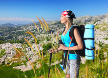 Traveling girl. With backpack hiking in the mountains, eco tourism, freedom concept Stock Photos