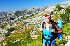 Traveling girl. With backpack hiking in the mountains, eco tourism Royalty Free Stock Image