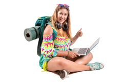 Traveling girl with backpack and laptop stock photography