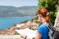 Traveling girl with map Stock Photography