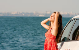 Traveling girl at the seaside Royalty Free Stock Photo