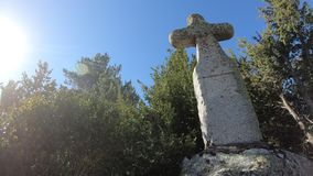 Granite cross and shining sun in the French Pyrenees, Aude in southern of France. Traveling on a granite cross and shining sun in the French Pyrenees, Aude in stock video footage
