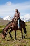 Traveling on horseback. Young woman tourist, traveling on horseback Stock Photography