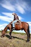 Traveling on horseback. Young woman tourist, traveling on horseback Stock Photo