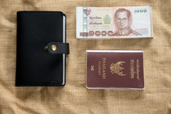 Traveling items: Thailand passport, wallet and Thai money. Travel concept flat lay royalty free stock photos