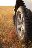 Traveling by jeep. Dry grass under the wheels Royalty Free Stock Image