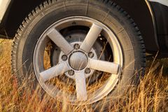 Traveling by jeep. Dry grass under the wheels Royalty Free Stock Photos