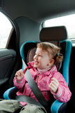 Traveling with joy and safety. Laughing child Royalty Free Stock Photos