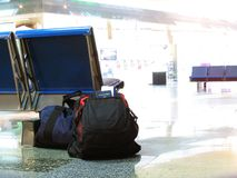 Traveling Light. A crisp, clean picture of luggage resting on an airport floor Stock Photography