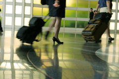 Traveling light in color. Airport rush blur motion silhouette legs Royalty Free Stock Photography