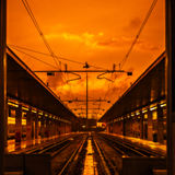 Traveling lines of trains at yellow sun set sky. Blured as abstract background. Traveling lines of trains at yellow sun set sky. Blured as abstract background Royalty Free Stock Images