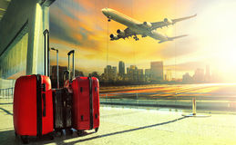 Traveling luggage in airport terminal building and jet plane fly Royalty Free Stock Image