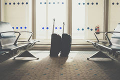 Traveling luggage in airport terminal. Suitcases in airport departure lounge stock photography