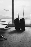 Traveling luggage in airport terminal. Suitcases in airport depa. Rture lounge Royalty Free Stock Images