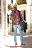 Traveling man with bag and map Royalty Free Stock Photography
