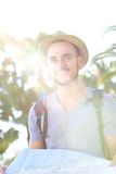 Traveling man with bag and summer hat Royalty Free Stock Photography