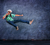 Traveling man jumping mid air with exciting emotion against ceme Royalty Free Stock Photography