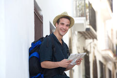Traveling man laughing outside with map Stock Photo
