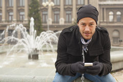 Traveling Man With Mobile Phone And Hat In City, Urban Space Stock Photography
