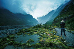 Traveling man take a photograph in franz josef glacier important traveler destination in south island new zealand Royalty Free Stock Photos
