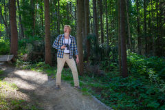 Traveling man walking in summer forest. Traveling man walking in green summer forest Royalty Free Stock Photos