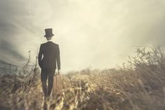 Traveling man walks solitary in wild nature Royalty Free Stock Photography