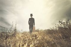Traveling man walks solitary in wild nature Stock Photo