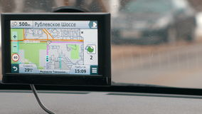 Traveling in Moscow with GPS device. MOSCOW, RUSSIA - FEBRUARY 2, 2015: Close-up shot of GPS nagivagion device showing next turning. Easy driving in the city stock footage