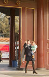 A traveling mother. A happy traveling mother and her baby is snapped at the gate of Forbbiden City, China Stock Images