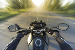 Traveling on a motorcycle on the mountain roads. Stock Images