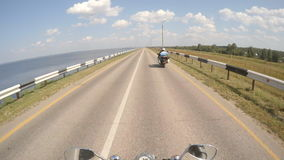 Traveling on a motorcycle together stock footage