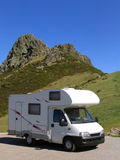 Traveling in motorhome. Motorhome parked at the mountain, near a rocky peak Stock Image