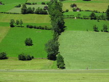 Traveling in green hill landscape by bike Stock Photos