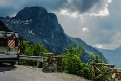 Traveling in the mountains with camper and bicycles. Traveling in the high mountains with camper and bicycles Stock Photography