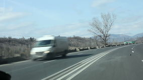 Traveling through the mountains in a car stock footage