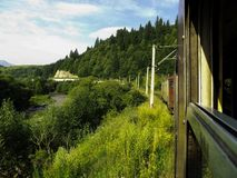 Traveling through the mountains by train.  Royalty Free Stock Photo