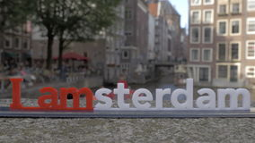 Traveling in Netherlands and visiting Amsterdam. Timelapse shot of the city with touristic ships sailing on the canals, I amsterdam slogan in foreground stock video