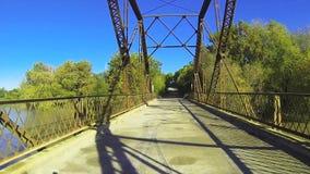 Traveling ob an old iron bridge. stock video