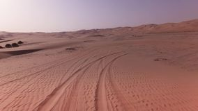 Traveling on an off-road car on the sand of Rub al Khali desert stock footage video stock video footage