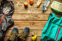 Traveling - packing preparing for adventure trip concept. Traveling - packing preparing for adventure school trip concept. Backpack, boots, jacket, lunch box stock photos